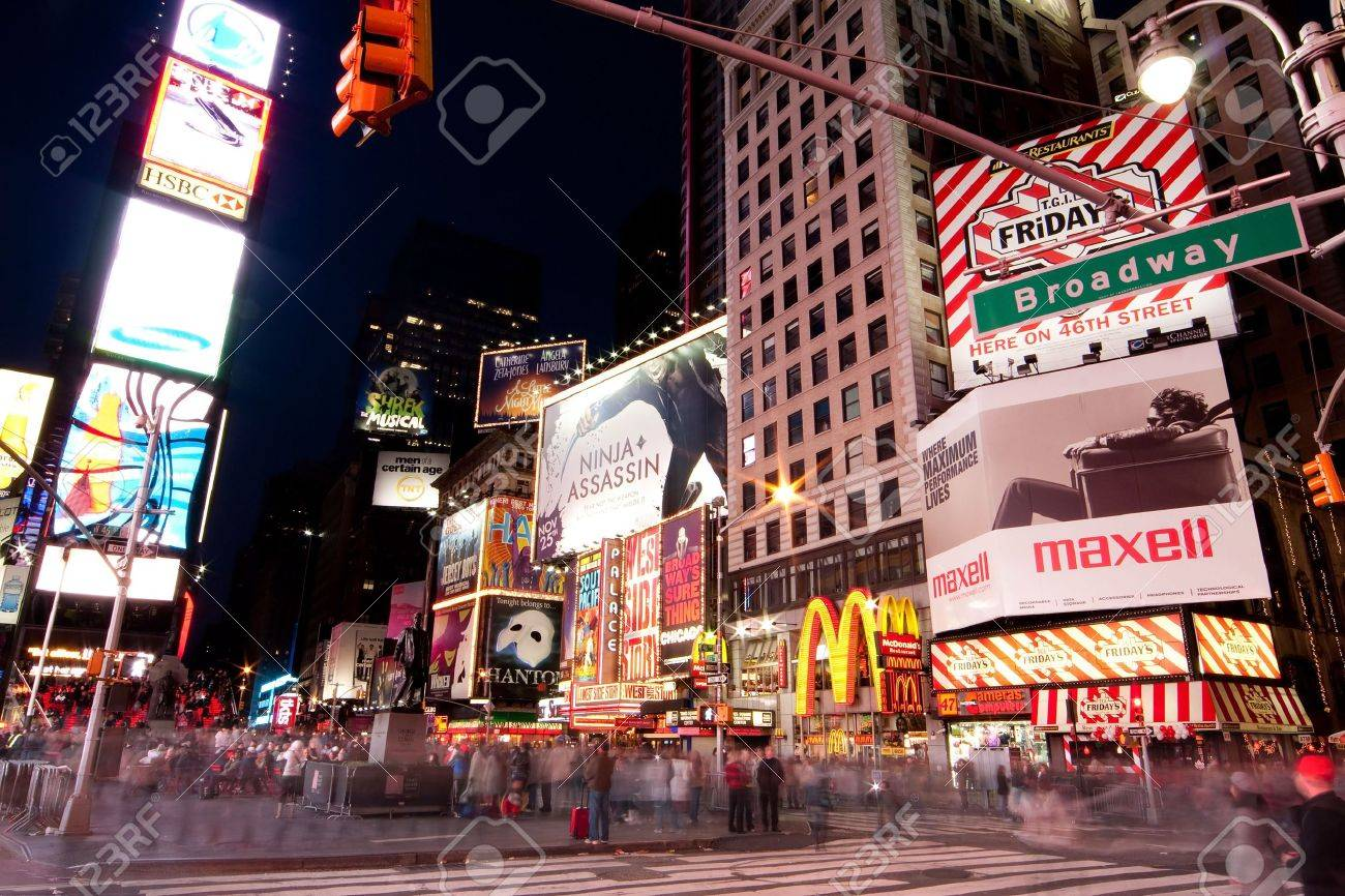 New York - 26 Nov. 2009: Night scene of Broadway at Times Square in Manhattan (New York City) with all the lit up billboards and advertisements, and many tourists people walking by. Stock Photo - 6886408