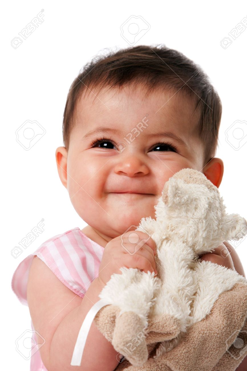 beautiful happy cute baby girl smiling face with security blanket