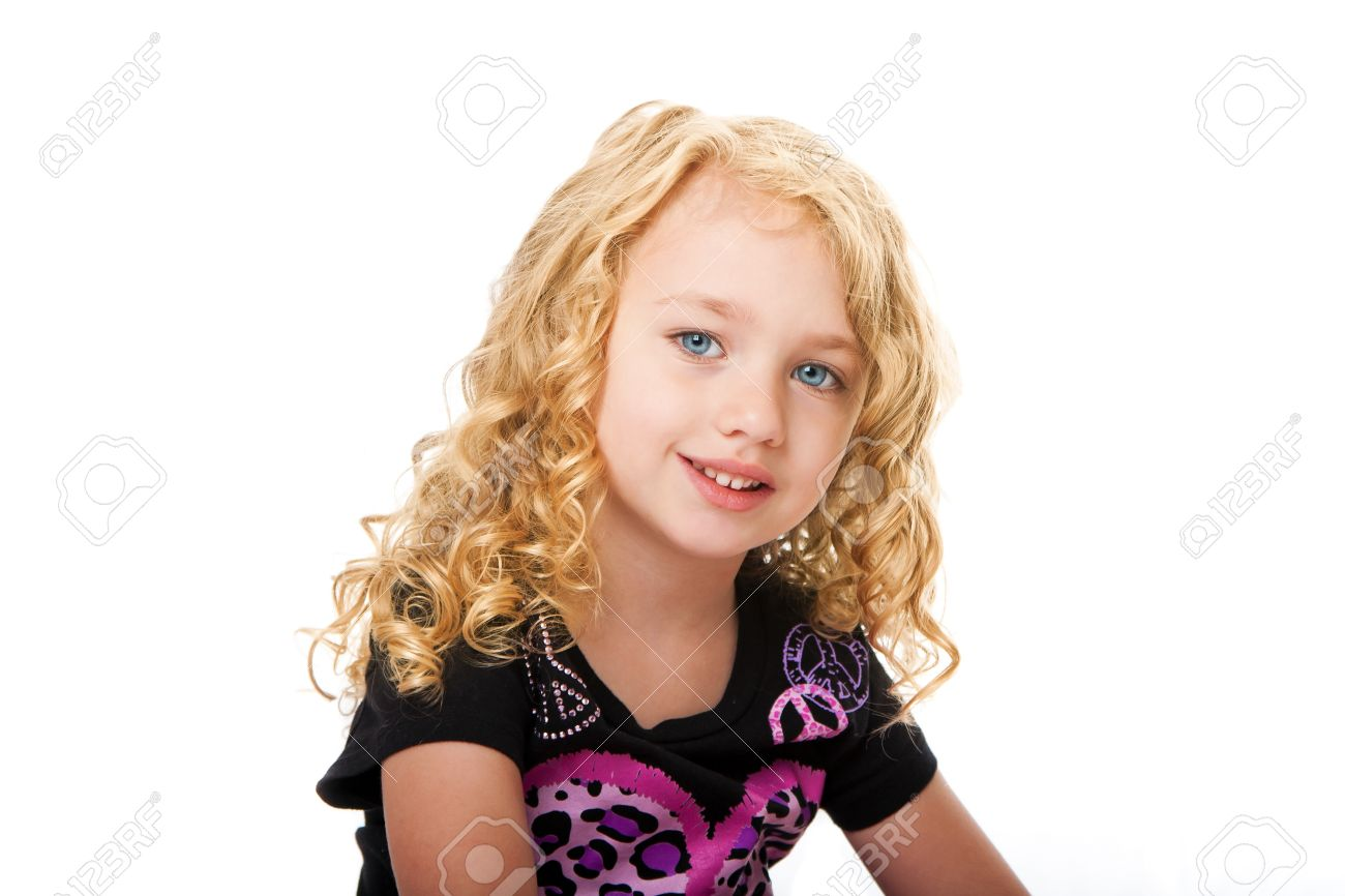 Beautiful happy smiling face of a young girl with golden blond hair and blue eyes, isolated. Stock Photo - 9731668