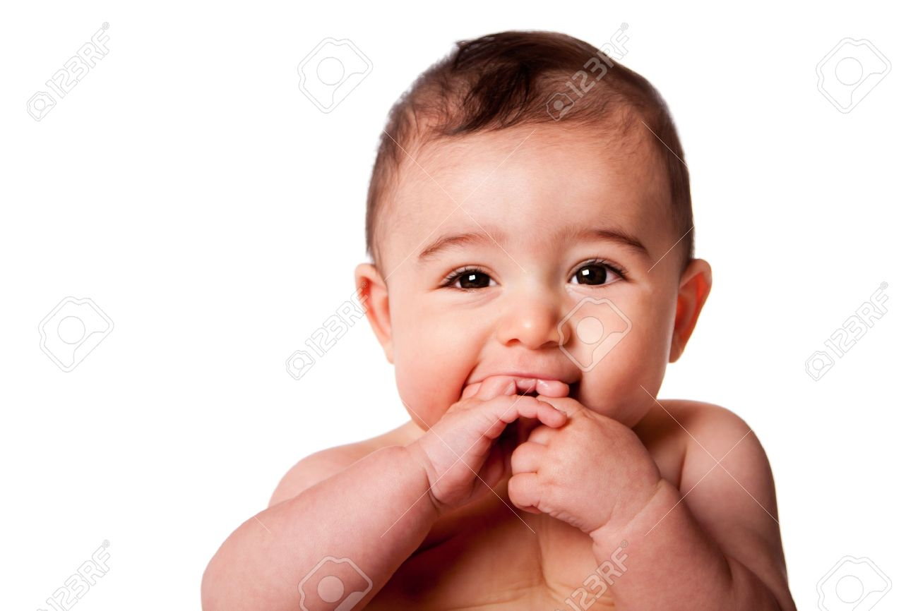 beautiful face of a happy cute baby infant with hands in mouth