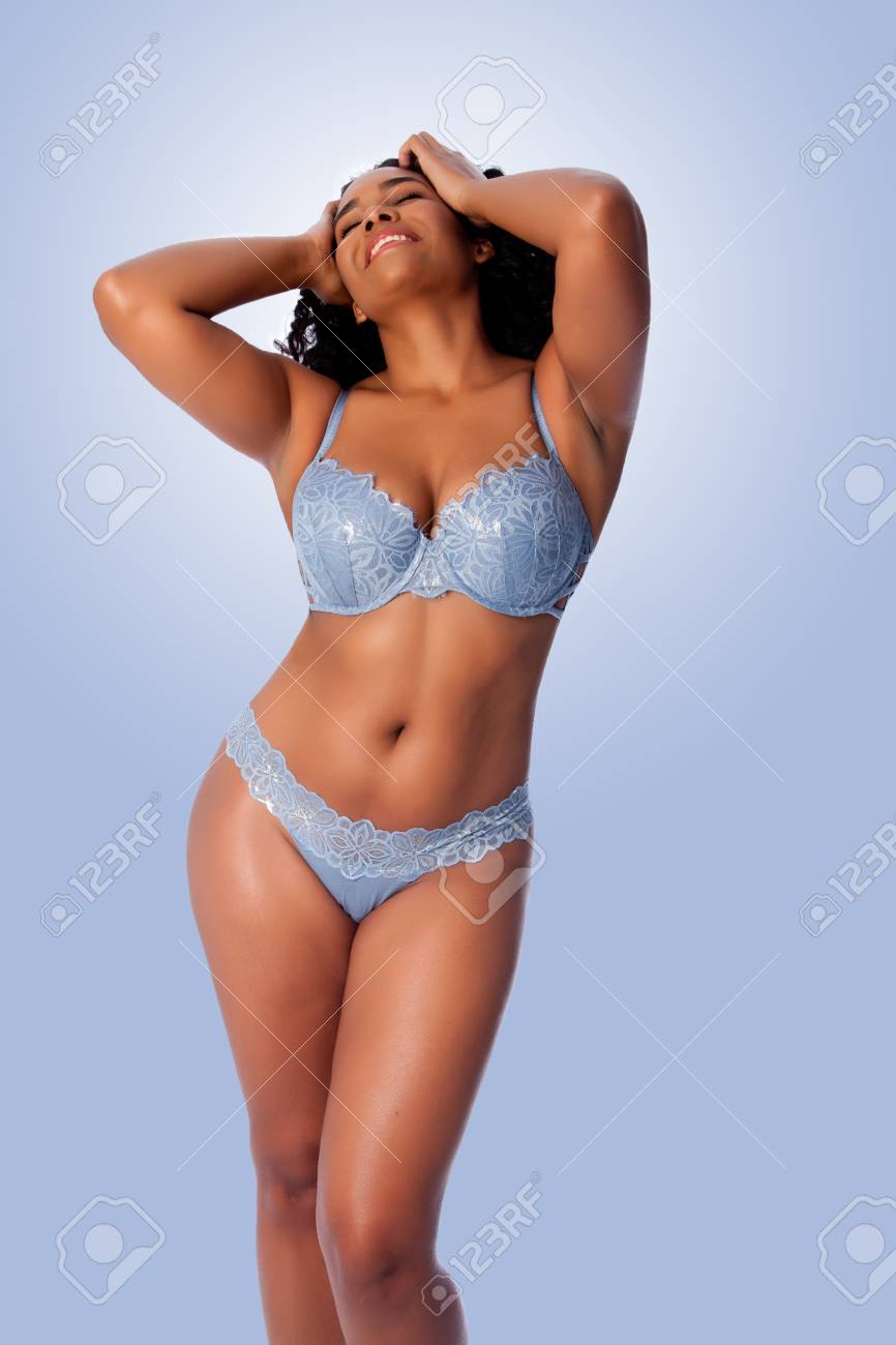 bc266aa0c72 Beautiful happy plus size sexy woman with curly hair in light blue lingerie  bra and thong