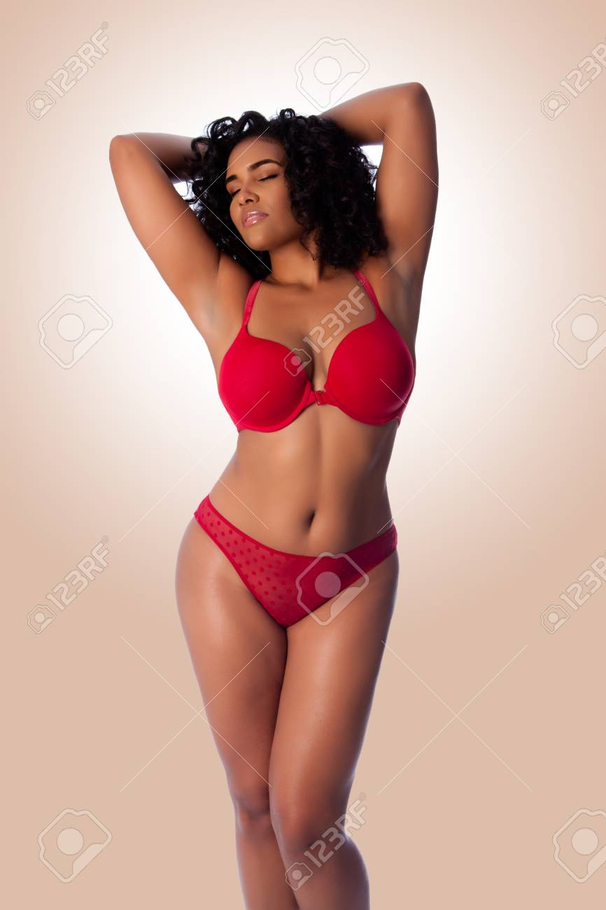7c8667344f Beautiful happy plus size sexy woman with curly hair in red lingerie bra  and thong underwear