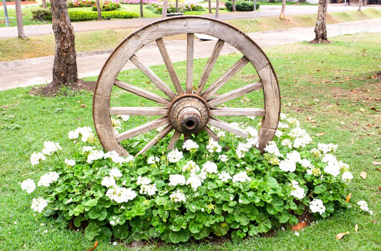 Old Wooden Cart Wheel With Flowers Decoration For The Garden,Old ...
