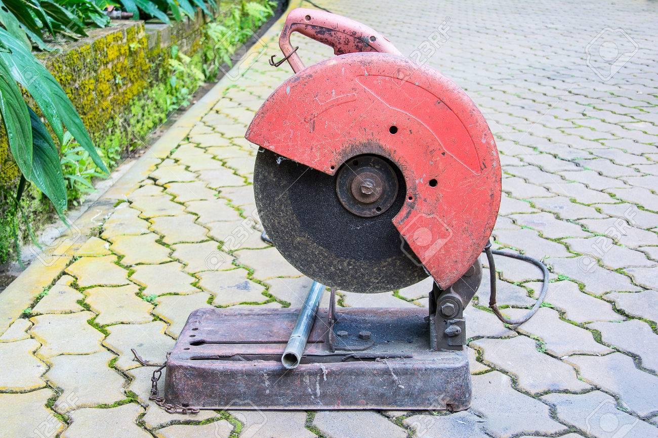 Circular saw prepare to cut metal pipe in the garden Stock Photo - 65855718 & Circular Saw Prepare To Cut Metal Pipe In The Garden Stock Photo ...