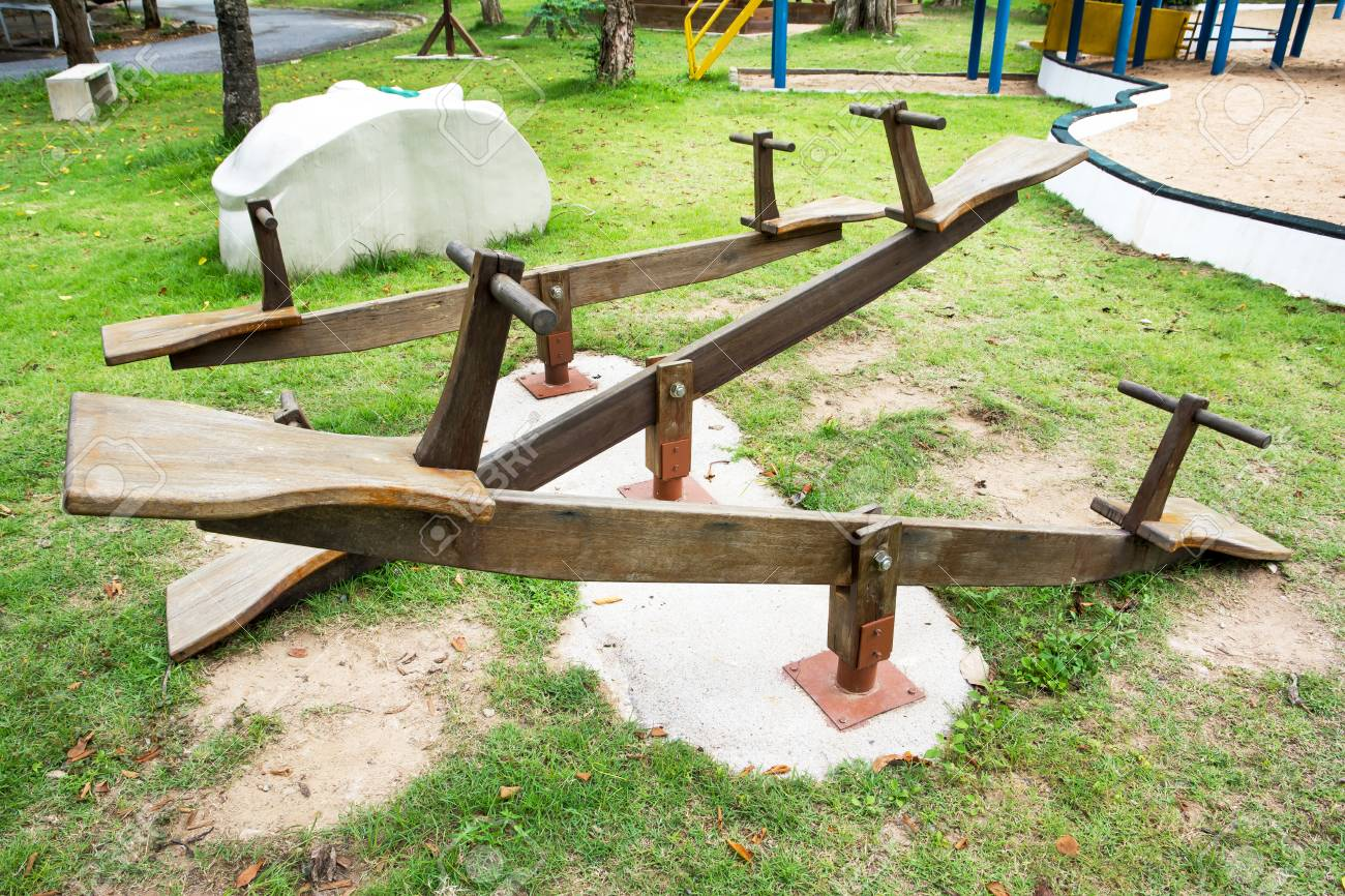 Wooden Seesaw At Public Playground Background