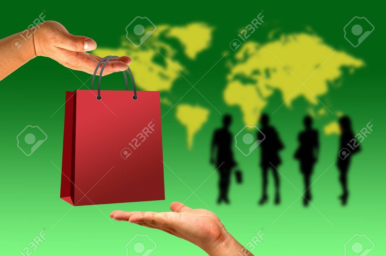 Shopping bag in hand on world and women background Stock Photo - 9841718