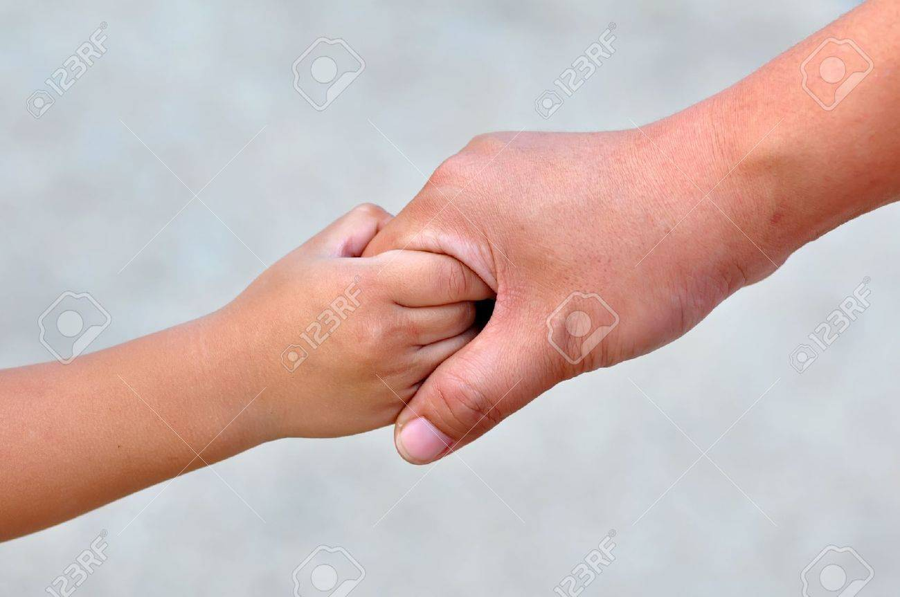 Adult and child's hands holding Stock Photo - 12120429