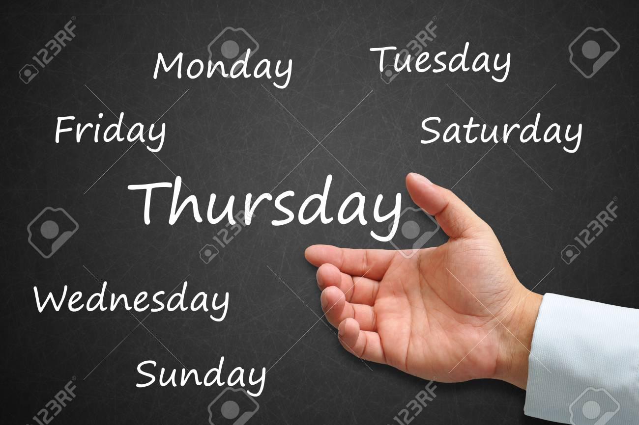 Thursday Written on Blackboard with hand Stock Photo - 14911970