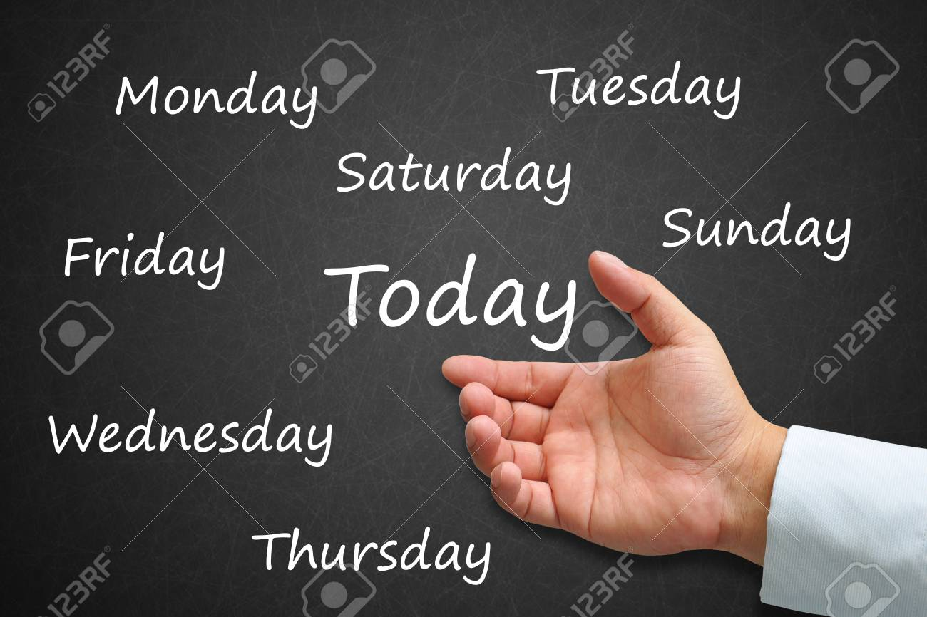 Today Written on Blackboard with hand Stock Photo - 14911986