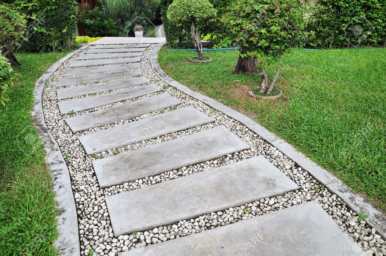Stone Walkway On A Grassy In The Garden Stock Photo Picture And