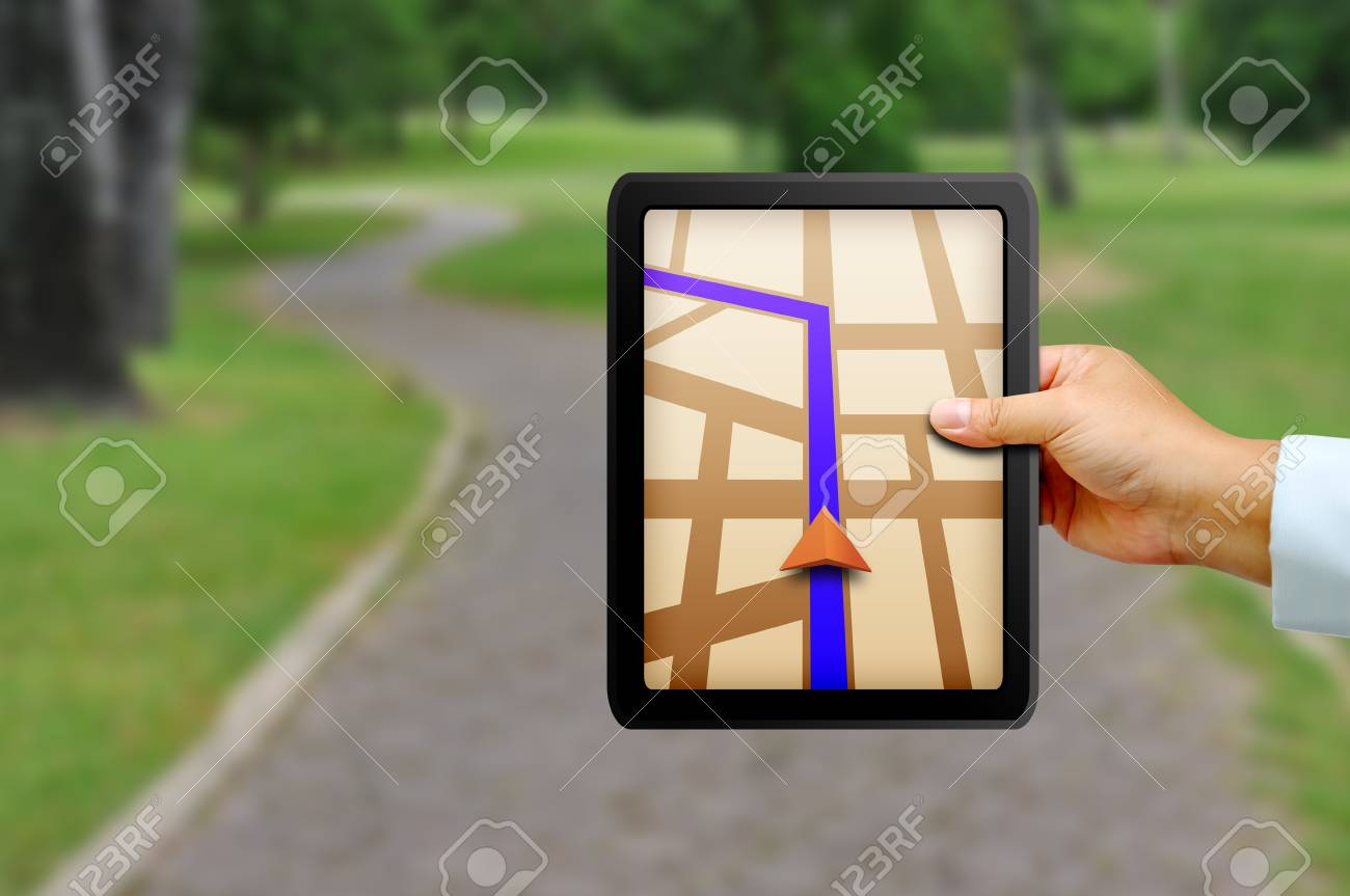 Male hand holding a touchpad gps Stock Photo - 18452260