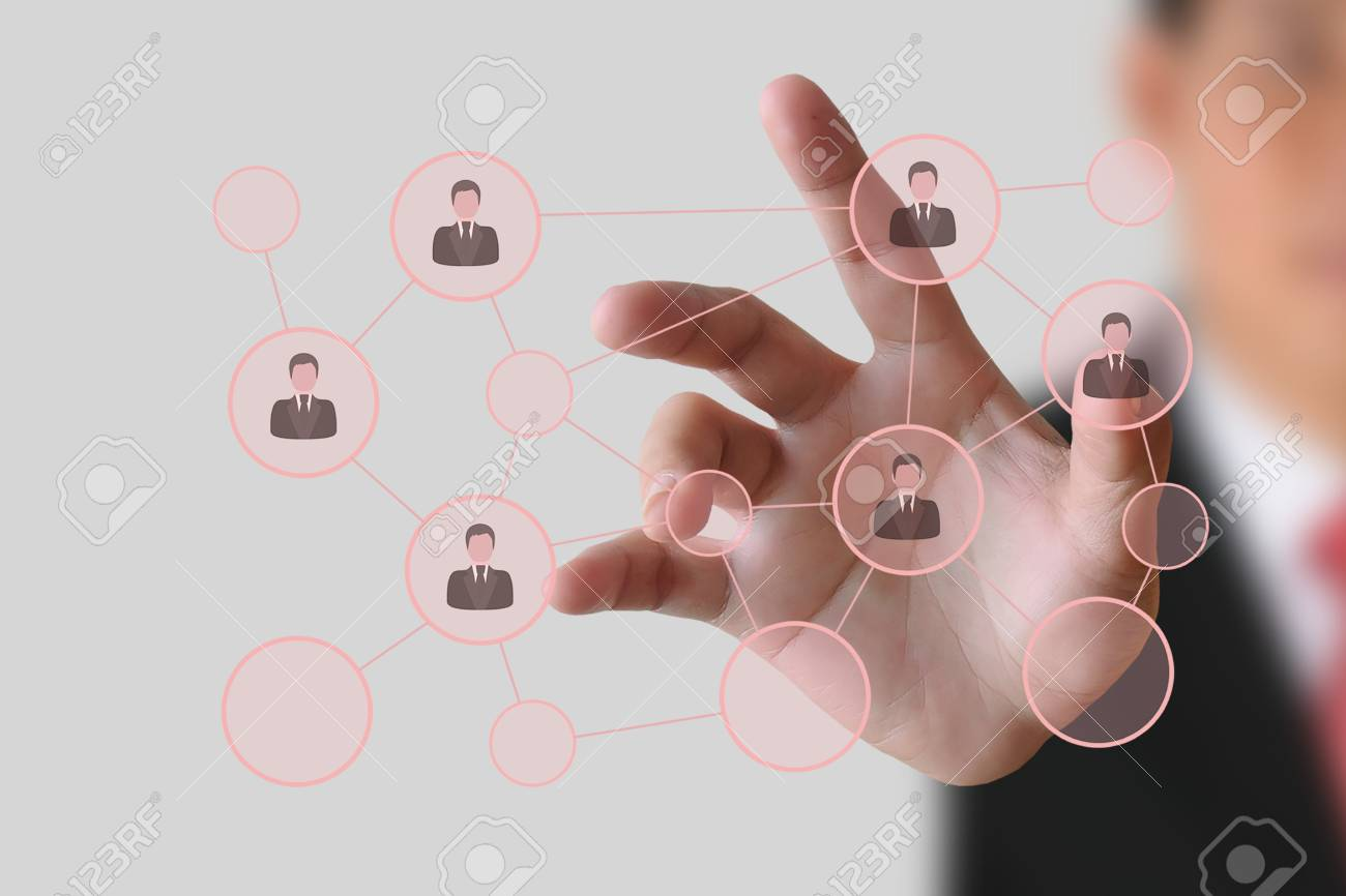 Businessman pushing human button and Social Network on the white background Stock Photo - 18563016