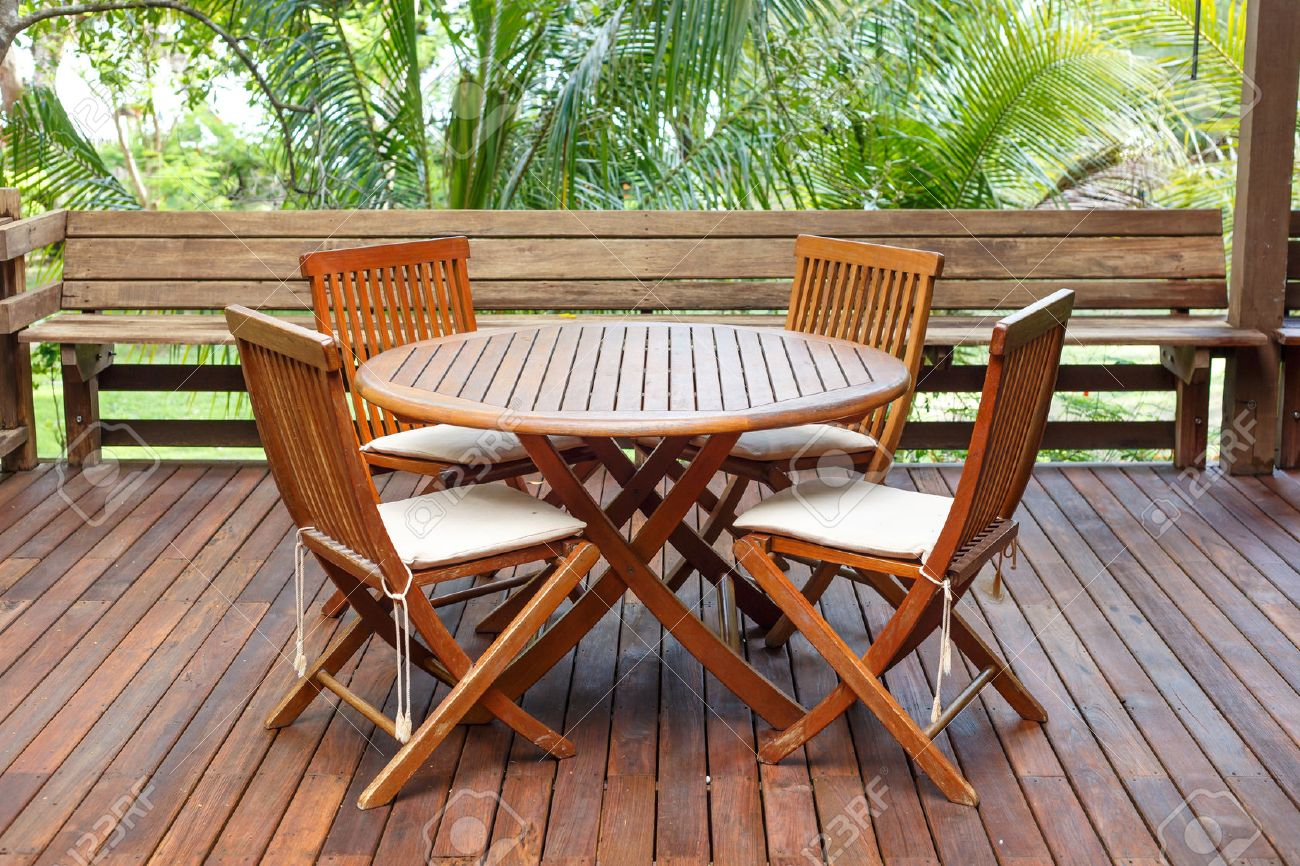 Captivating Patio Furniture: Teak Wood Furniture Stand On The Terrace