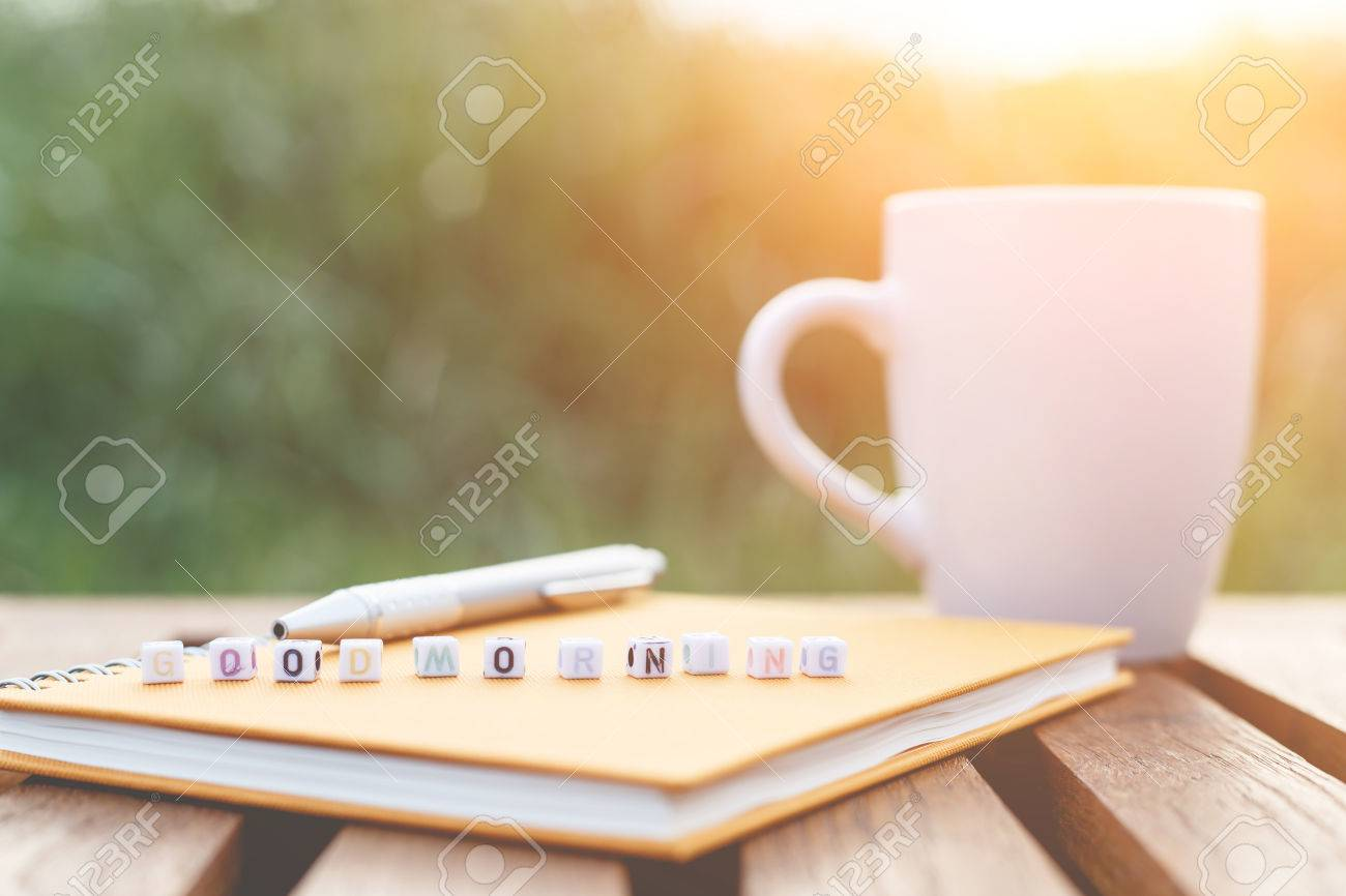 Good Morning Written In Letter Beads And A Coffee Cup On Table Stock