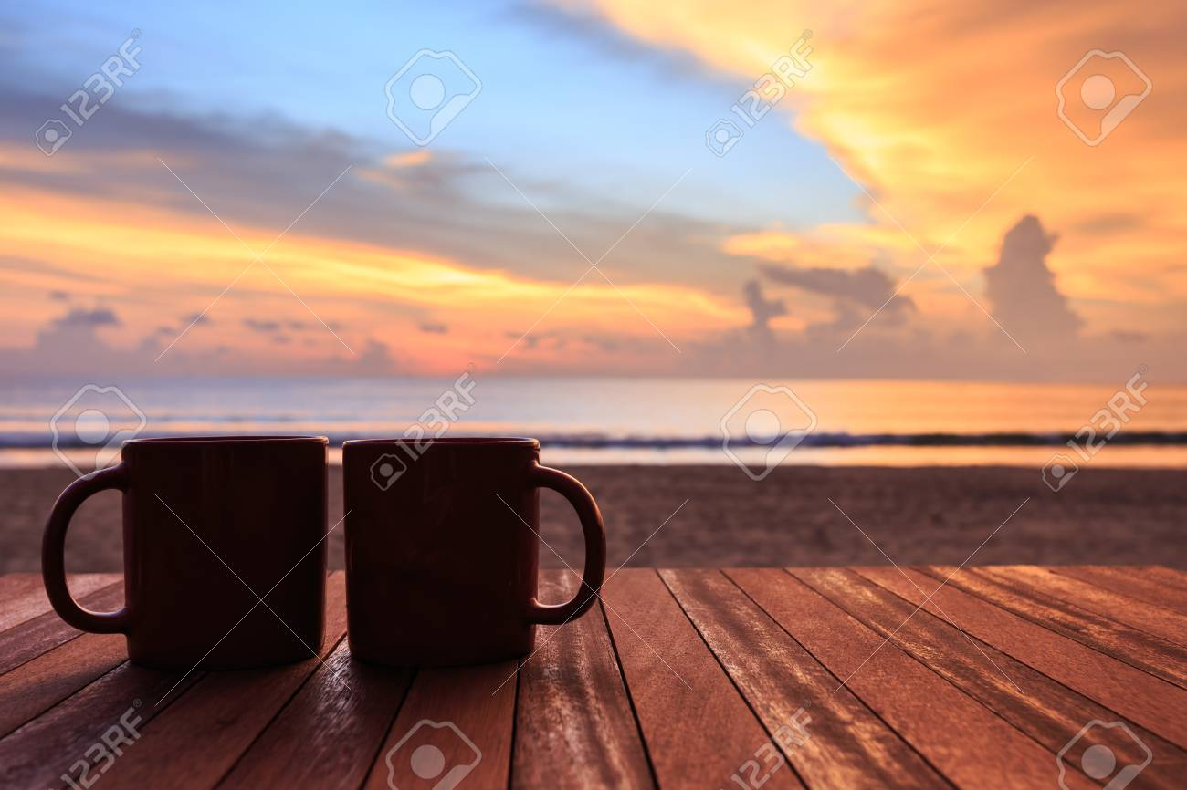 Close up coffee cup on wood table at sunset or sunrise beach Stock Photo - 46971317 & Close Up Coffee Cup On Wood Table At Sunset Or Sunrise Beach Stock ...