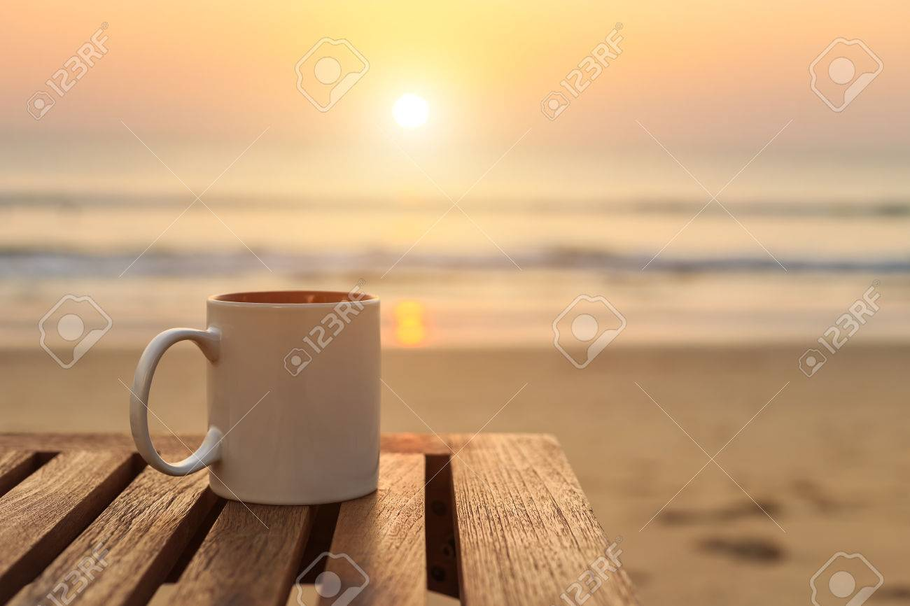 Close Up Coffee Cup On Wood Table At Sunset Or Sunrise Beach Stock Photo Picture And Royalty Free Image Image 47639956