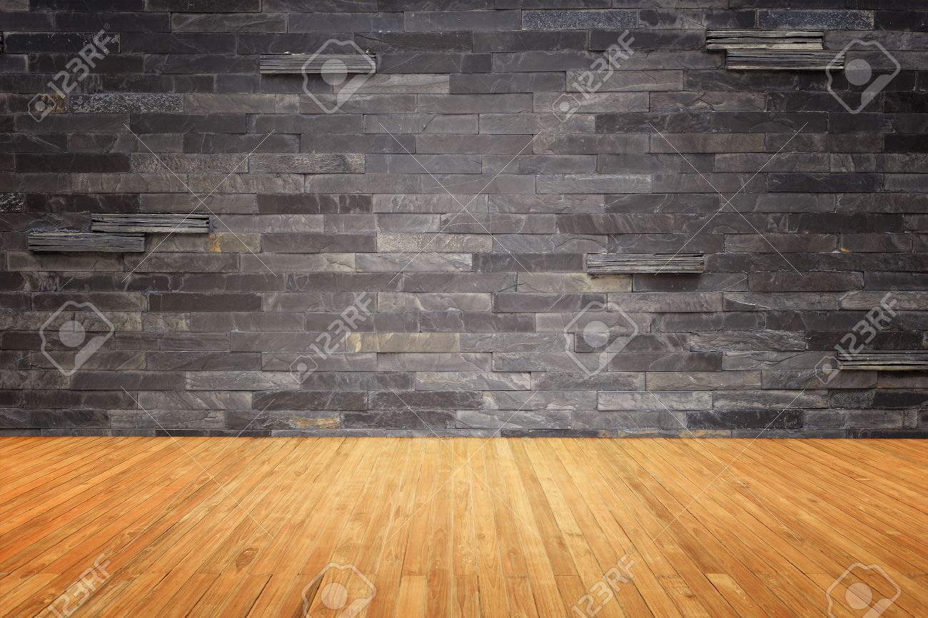 Empty top of wooden floor and natural stone wall background Banque d'images - 47639334