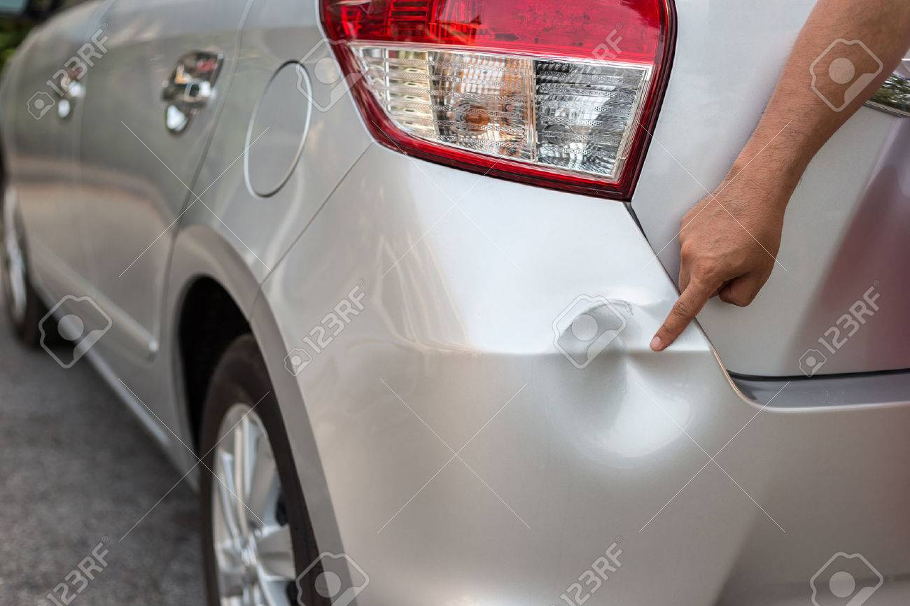 Backside of new silver car get damaged by accident Banque d'images - 57108597