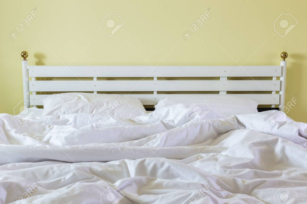 Close Up White Bedding Sheets And Pillow, Messy Bed Concept Stock Photo    57108993