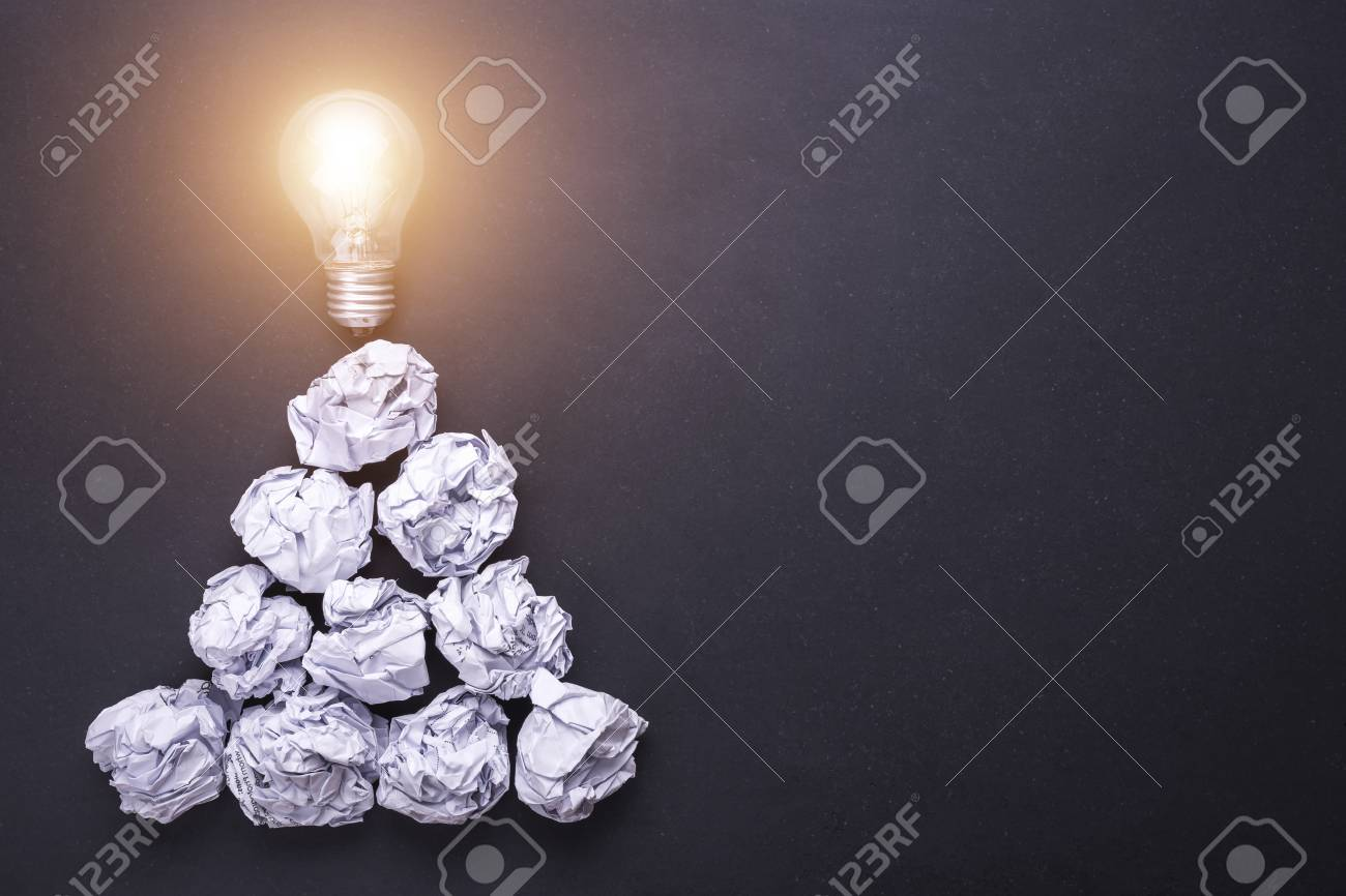 Stock Photo   Top View Crumpled White Paper And Light Bulbs On Black Stone  Board. Create Idea Concept