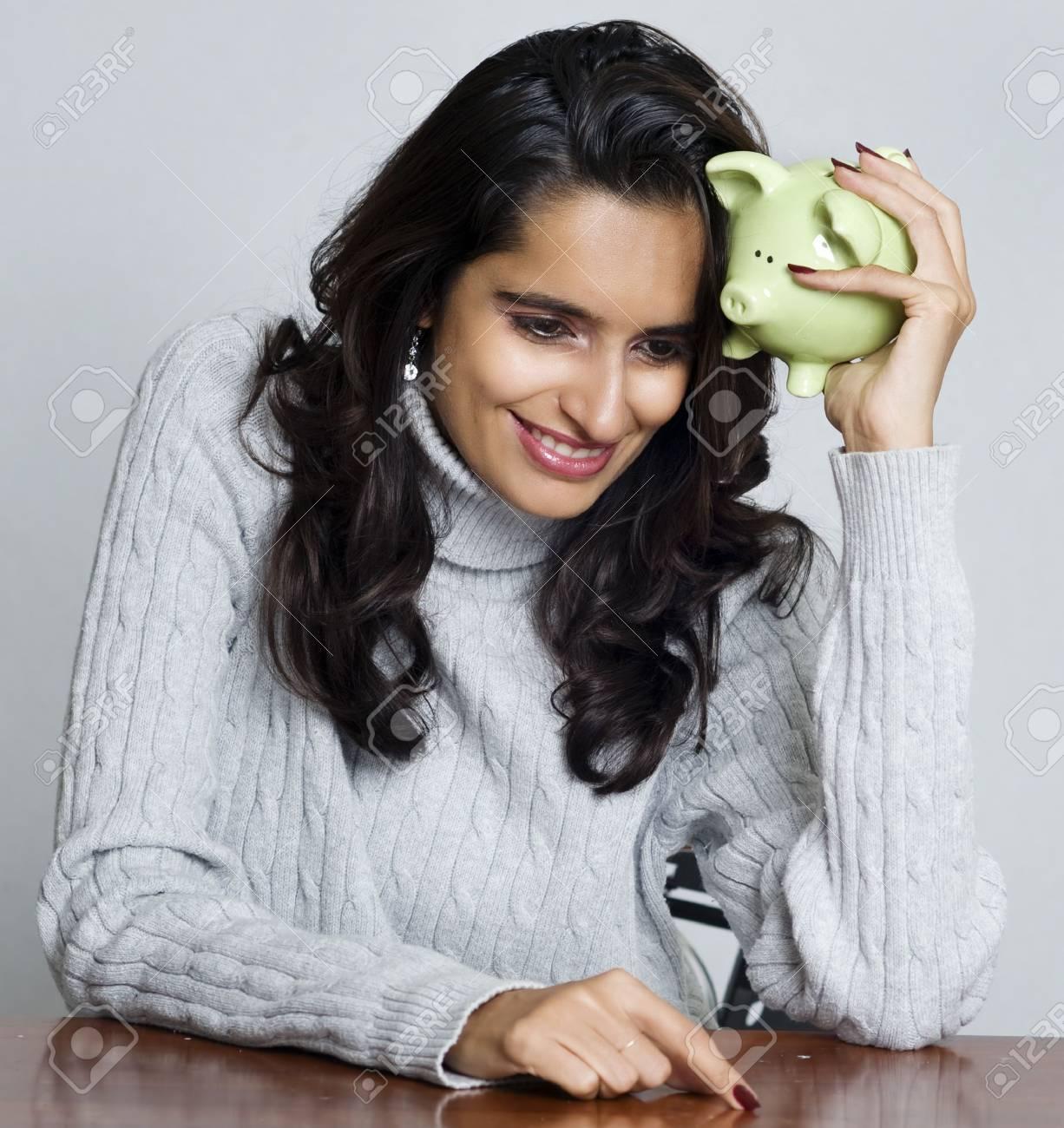 Woman holding piggy bank Stock Photo - 4957135