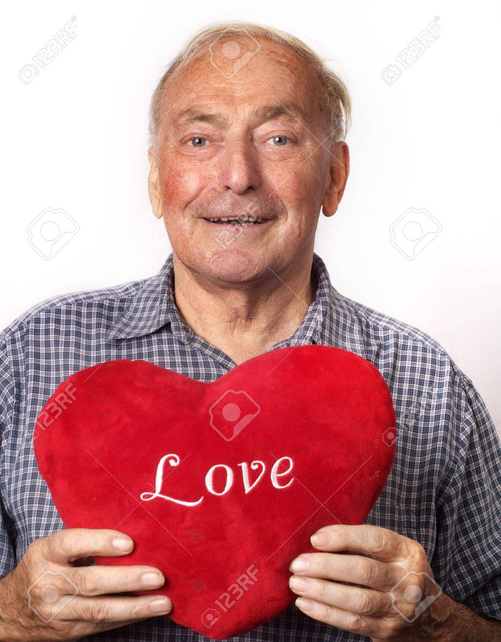 A mature man holding a red heart. Stock Photo - 7933879
