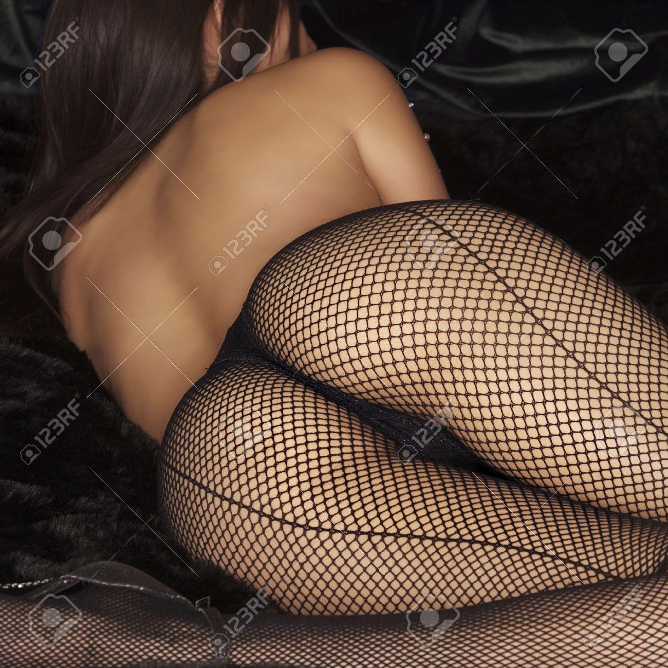 Beautiful woman wearing fishnet stockings Stock Photo - 10204496