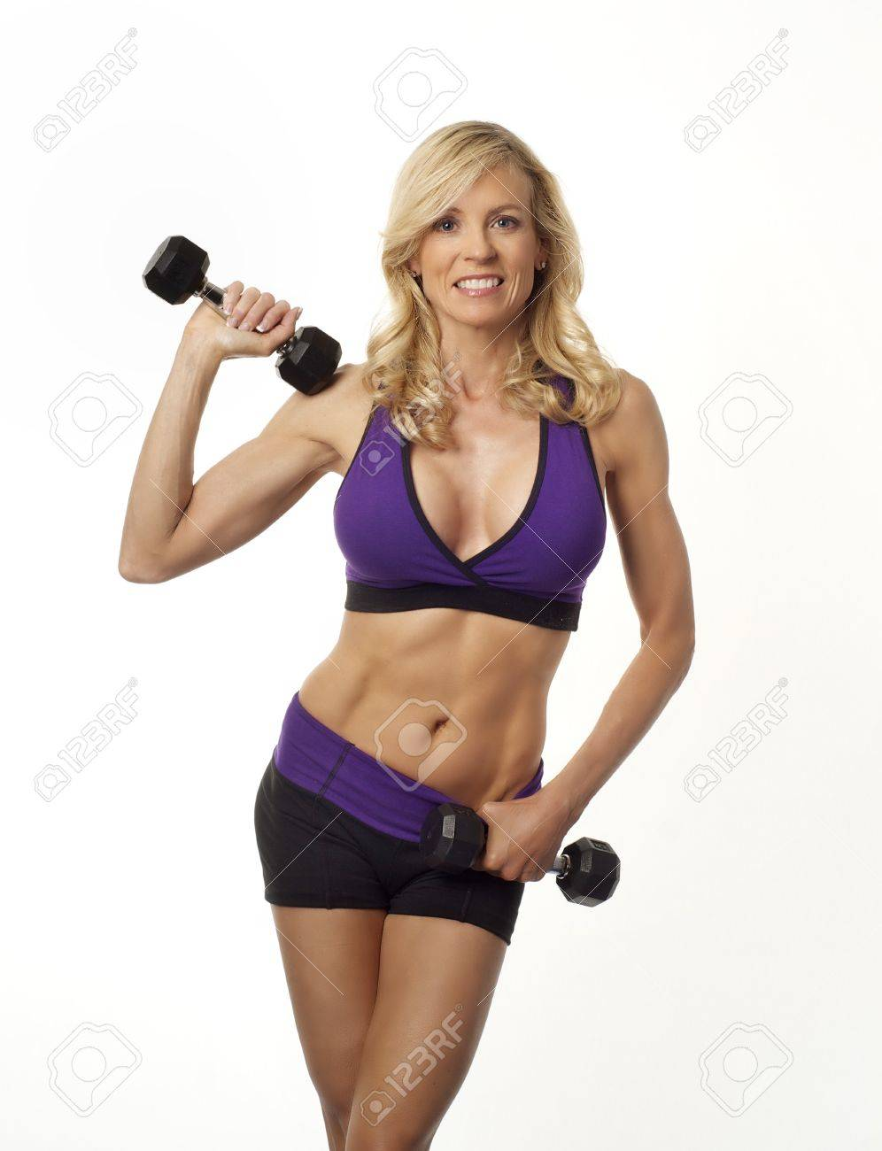 Attractive woman maintaing weight and vitality by exercising Stock Photo - 12614639