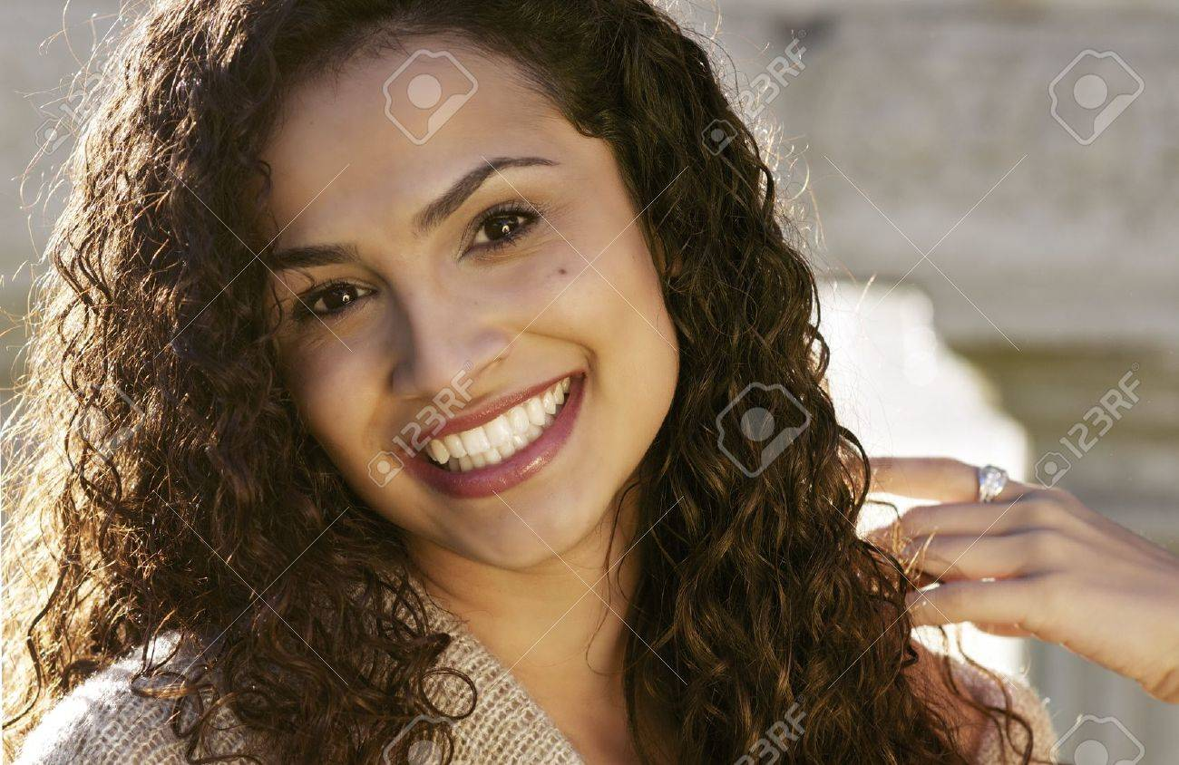 Happy smiling radiant beautiful young woman Stock Photo - 16443805
