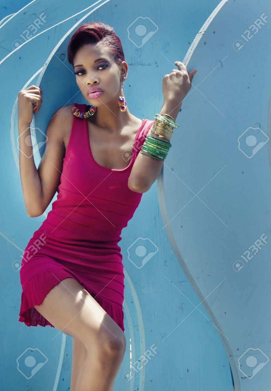 Beautiful fashion model with short hair pink dress Stock Photo - 19339555