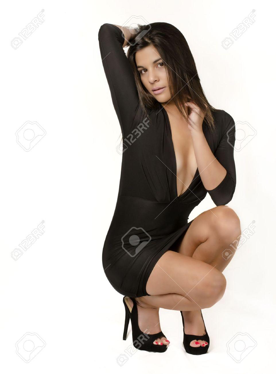 Black dress woman - Beautiful Young Woman Wearing Black Dress Stock Photo 21533375