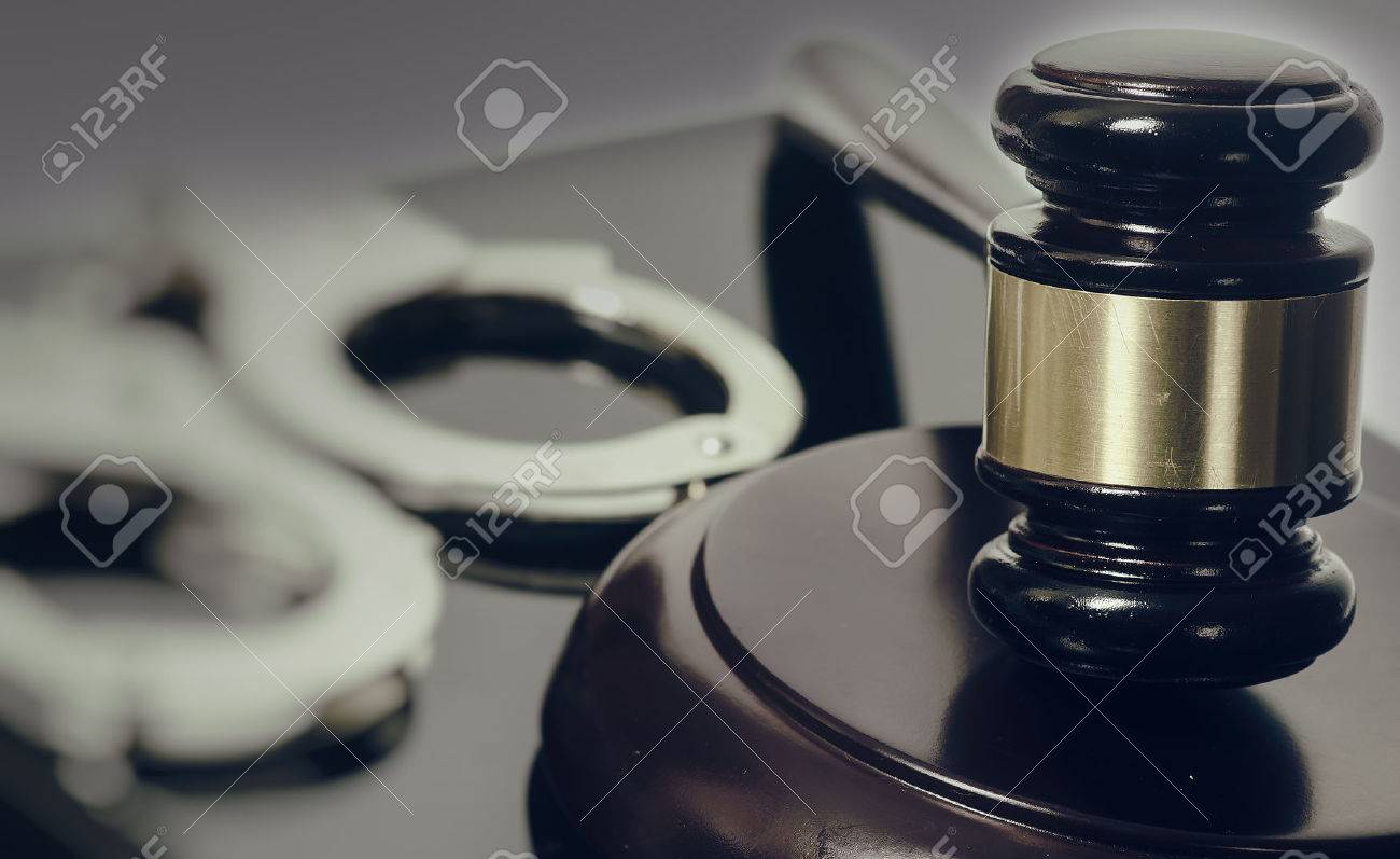 Legal law concept image - gavel and handcuffs - 56099942
