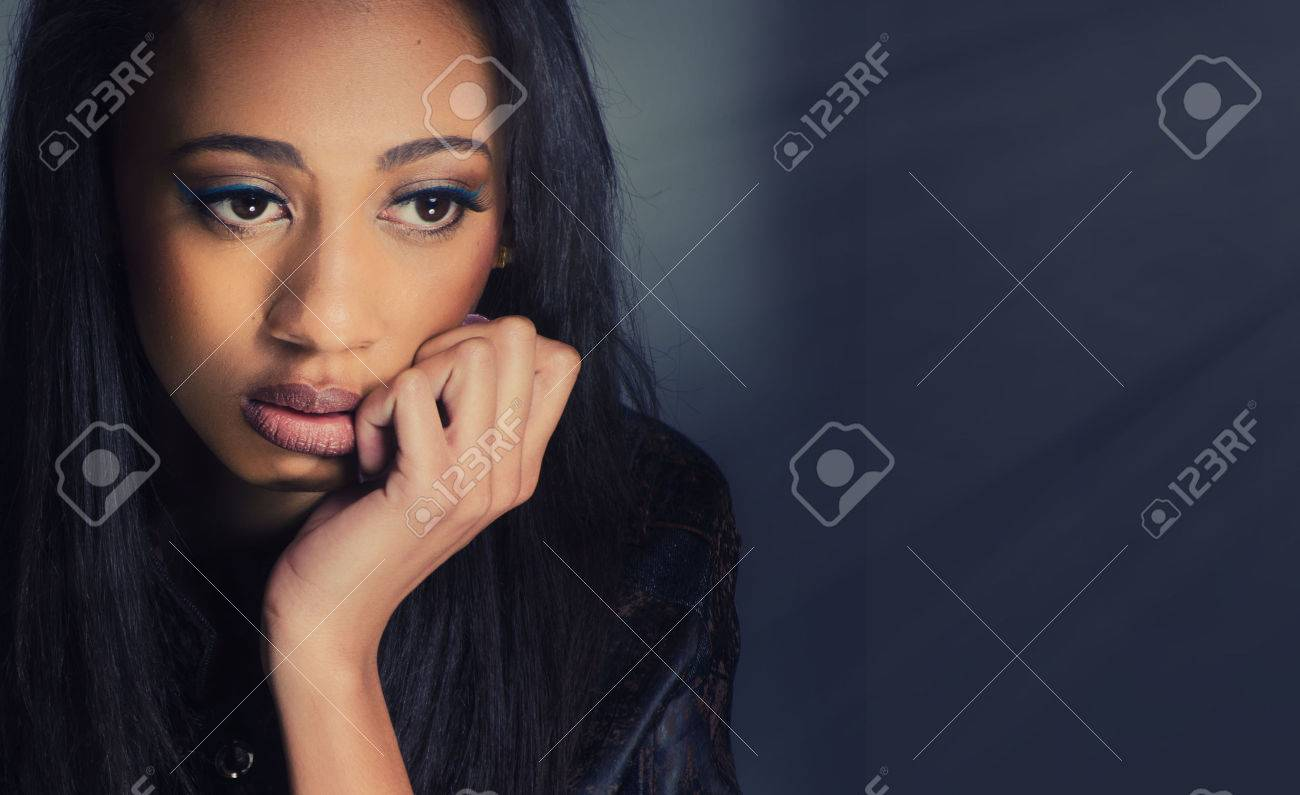 Attractive young woman looking thoughtful and contemplative. - 58103156