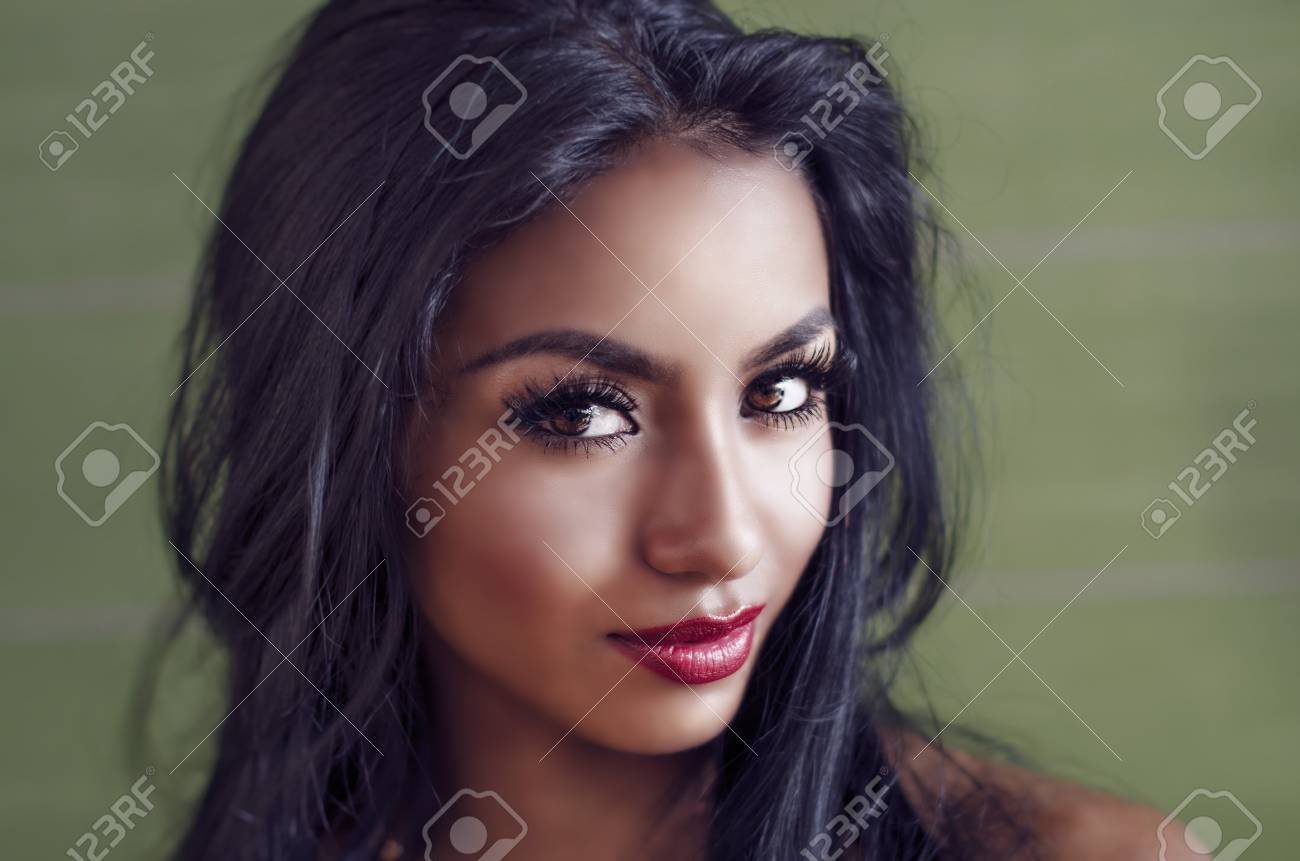 Beautiful young woman with dark exotic looks - 101281066
