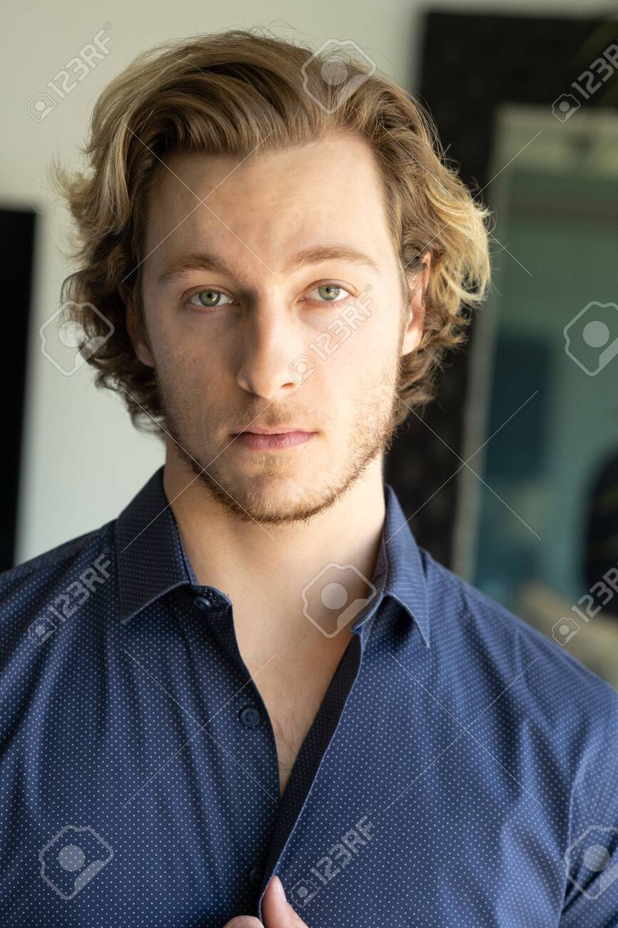 Handsome young man blonde hair and stubble wearing shirt - 121649752