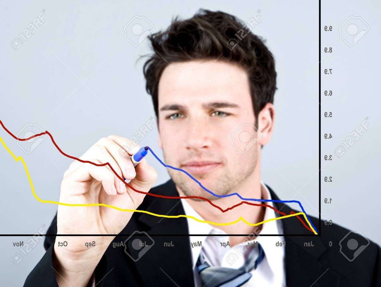 Attractive business man drawing on a graph - 4408779