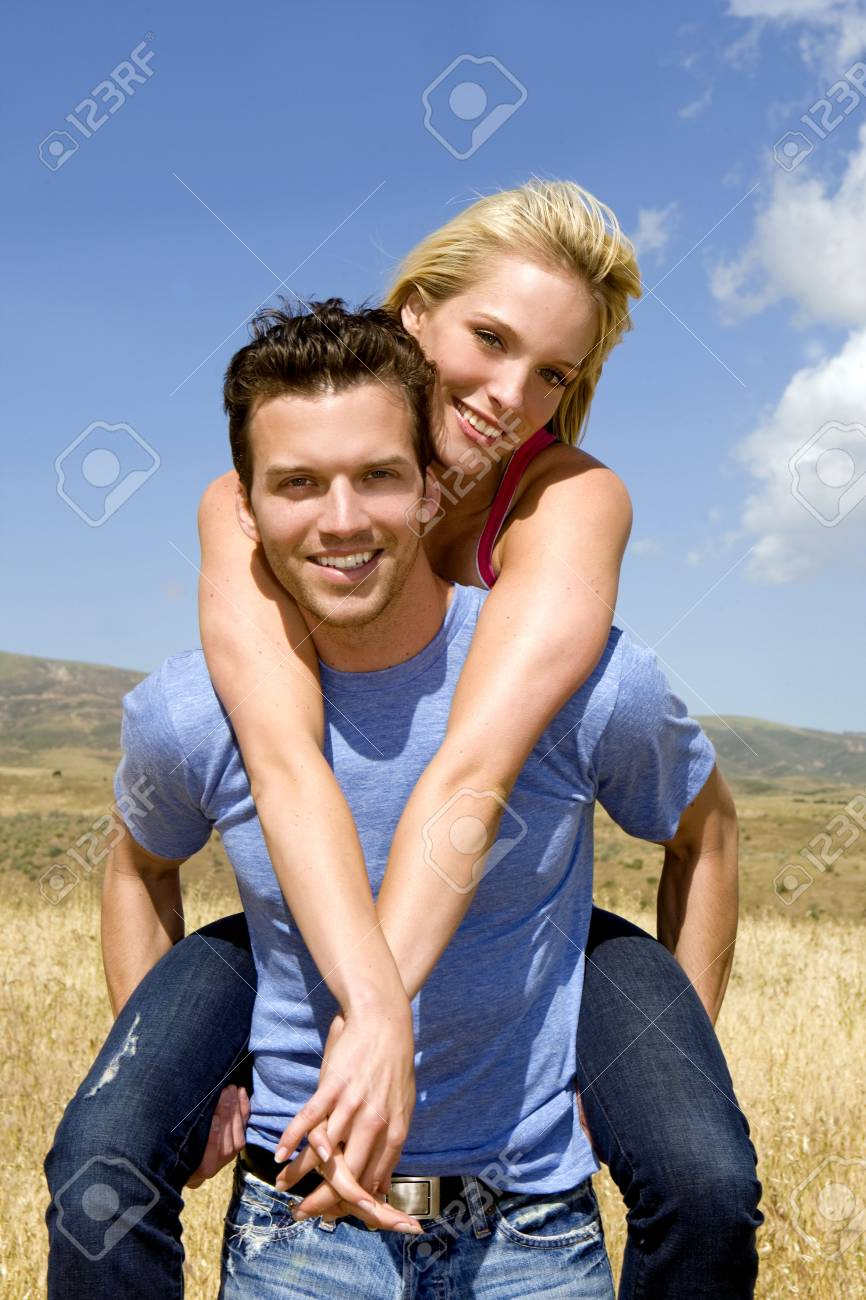 Attractive young couple playing outside - 4924083