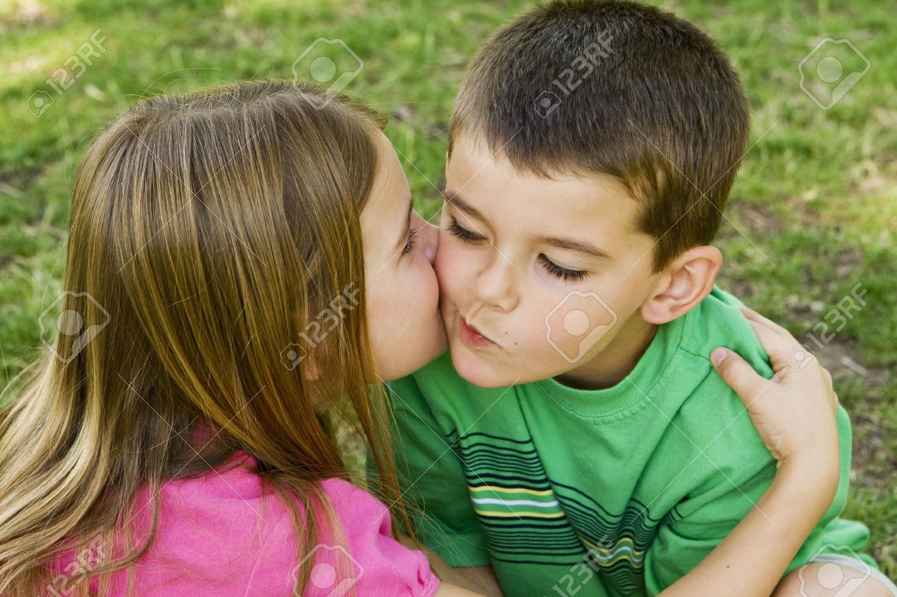 Sister giving her brother a kiss on the cheek - 4925725