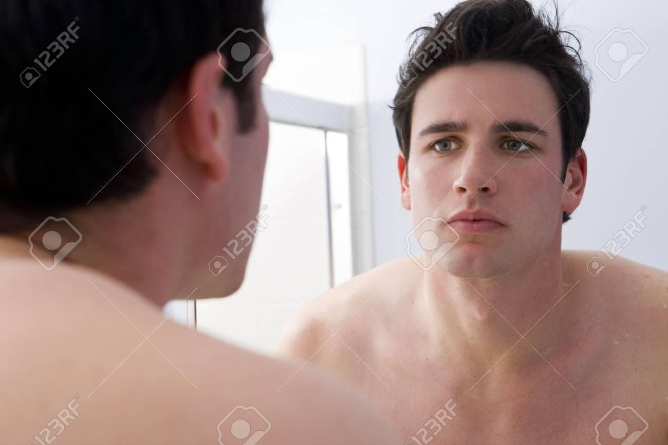 Man looking at his reflection - 4949995