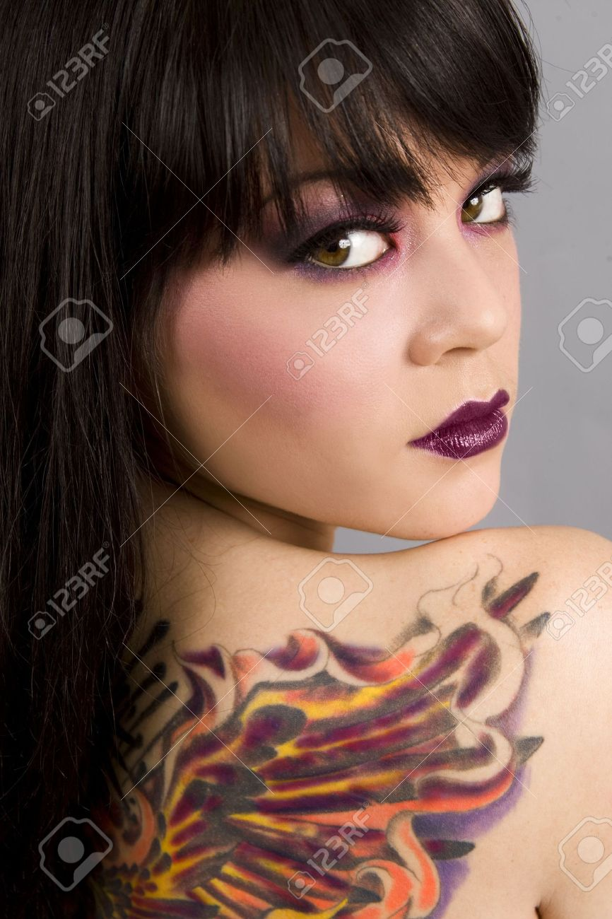 Beautiful exotic woman with colorful tattoo - 4949911