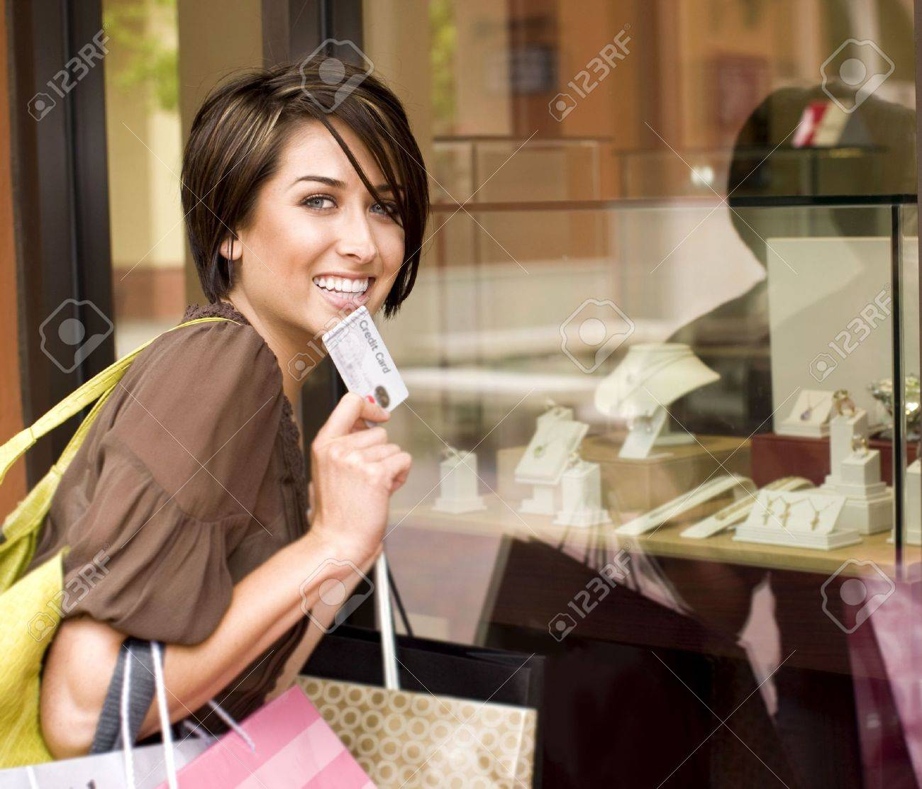 Happy woman shopping with her credit card - 5047209