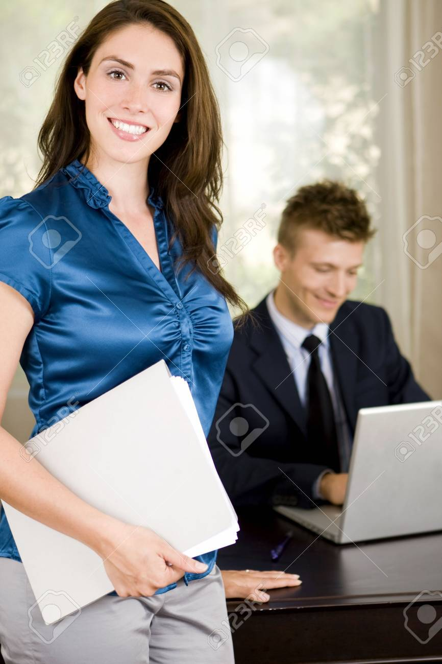 Business professionals working in an office - 5047235