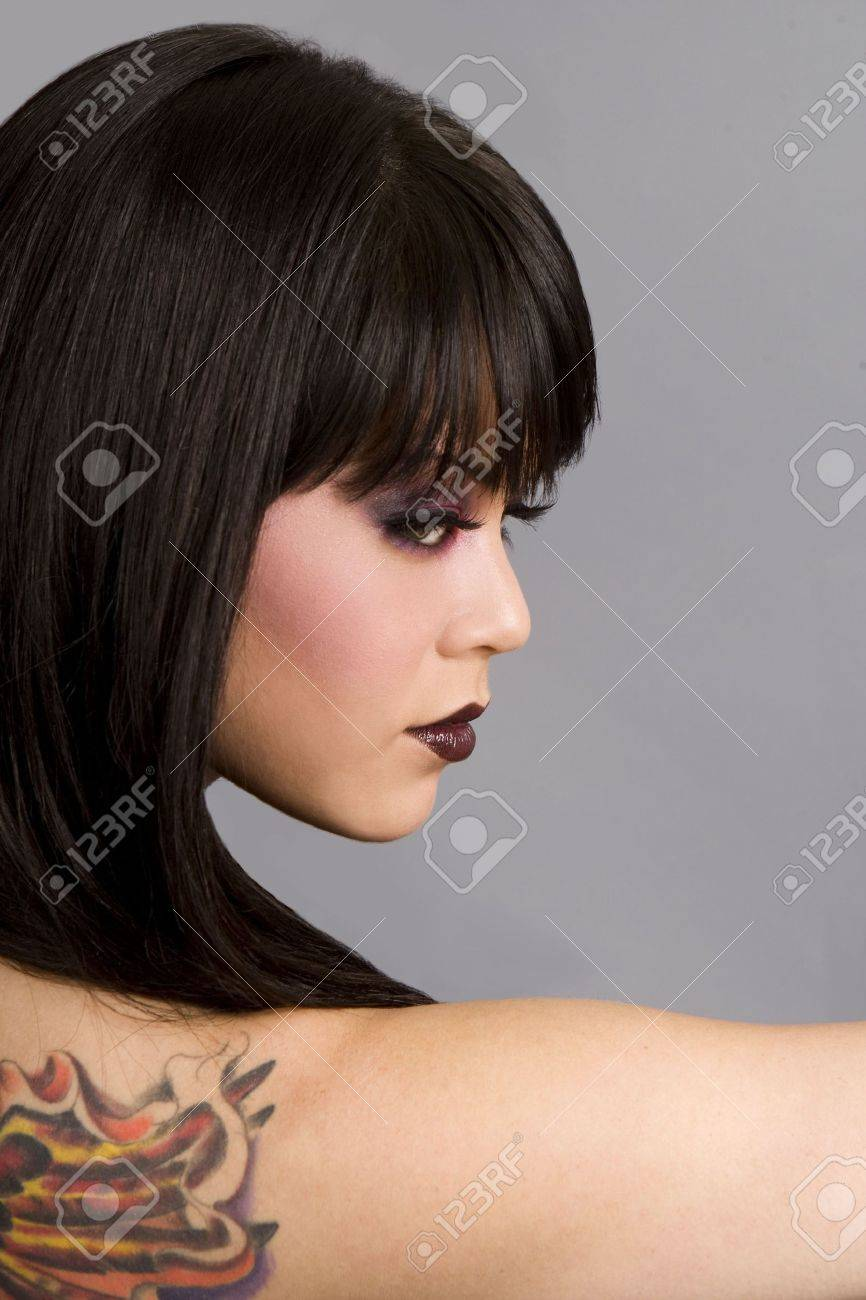 Beautiful exotic woman with colorful tattoo - 5065272
