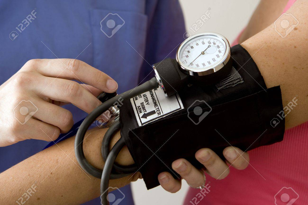 Doctor or nurse taking a patient's blood pressure - 5132633