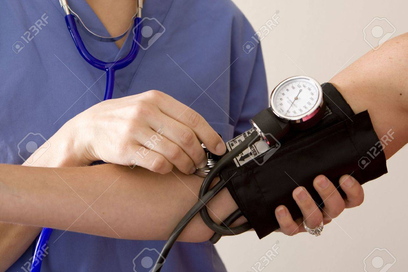 Doctor or nurse taking a patient's blood pressure - 5201010