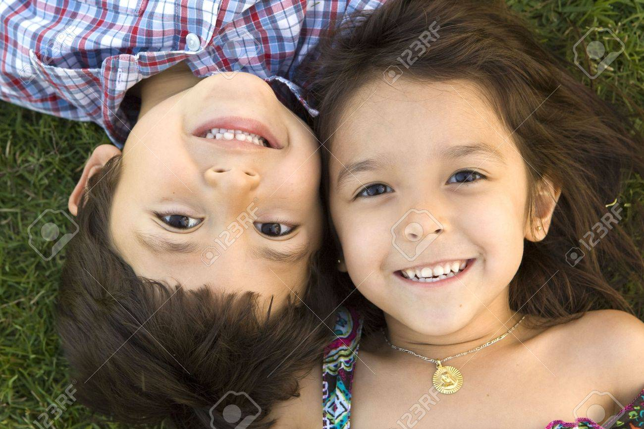 Brother and sister playing outside - 5372545