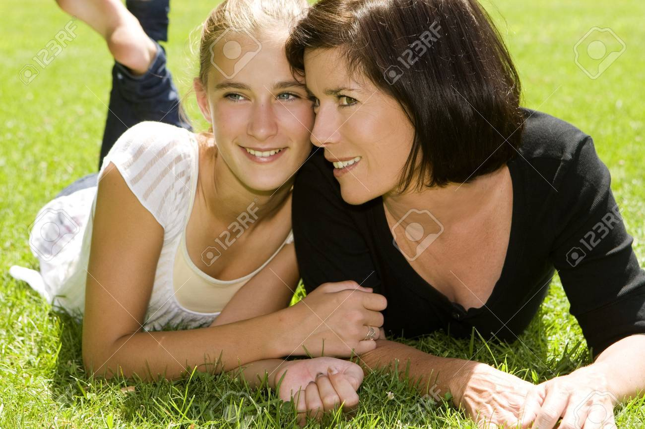 Mother and daughter outdoors on a Spring day - 5454957