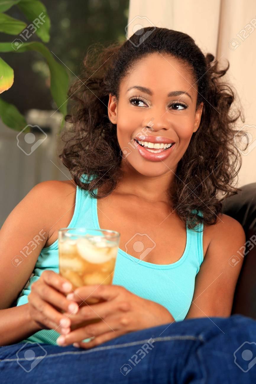 Pretty woman drinking iced tea - 5481542