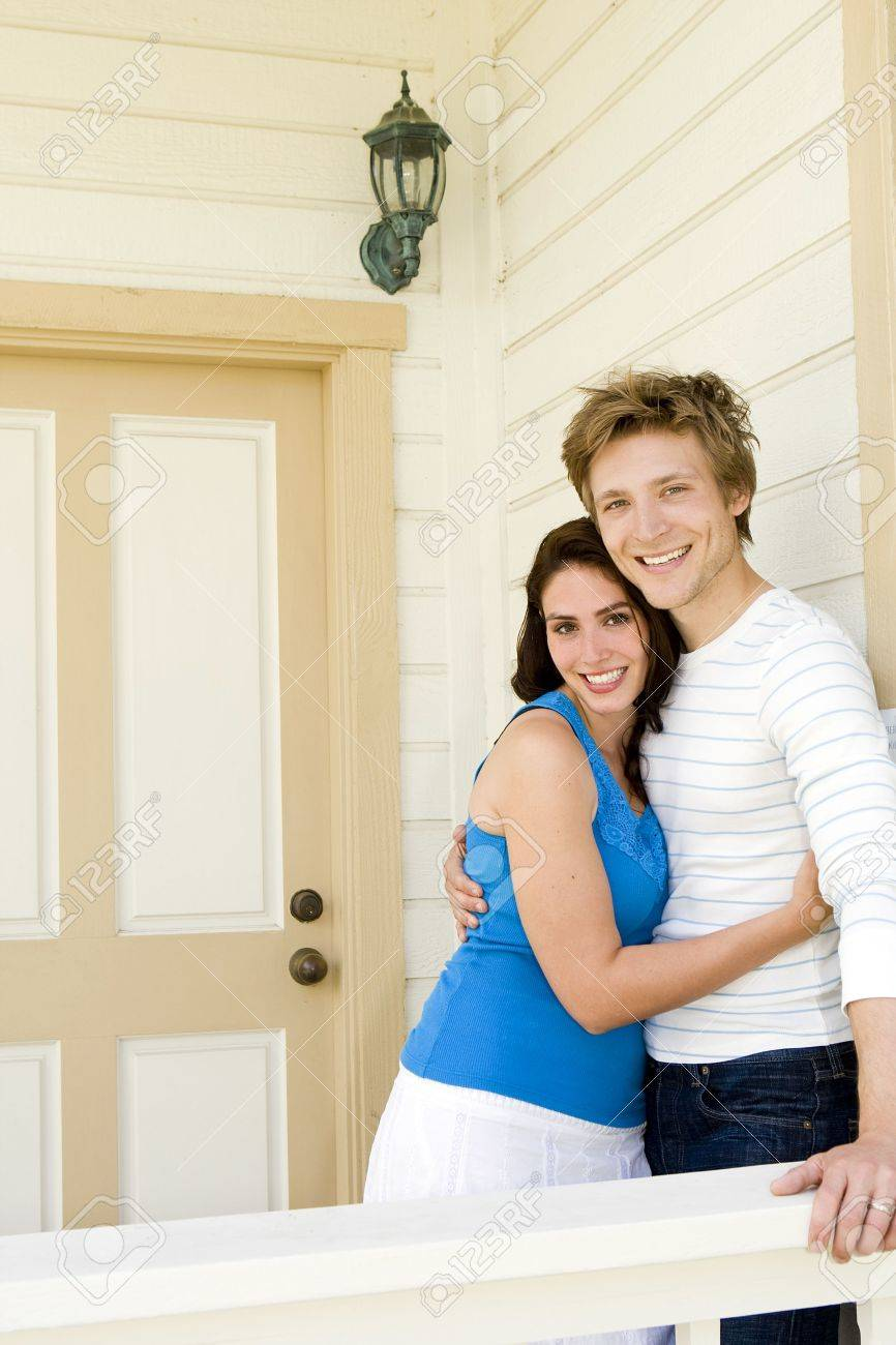 Loving couple outside of their home - 5481573