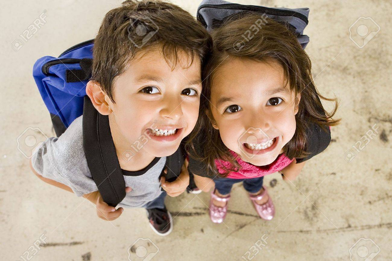 Little boy and girl with their book bags - 5534721